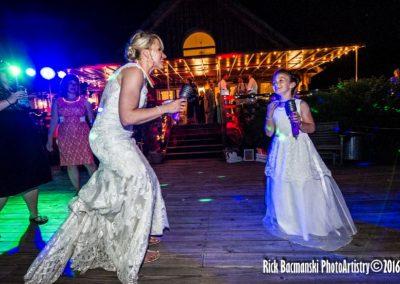 Bride and Bridemaid Dancing on Patio