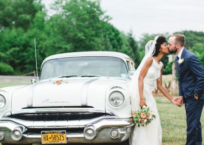 Buttonwood Grove Wedding Couple Kissing Vintage Car