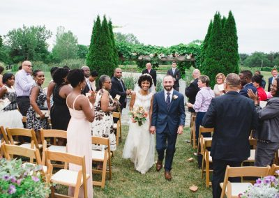 Buttonwood Grove Wedding - Married Couple Walking Down the Aisle Outside